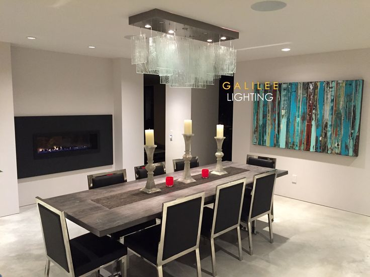 A Beautiful Modern Clear Glass Chandelier Over Dining Table Designed By Galilee Lighting