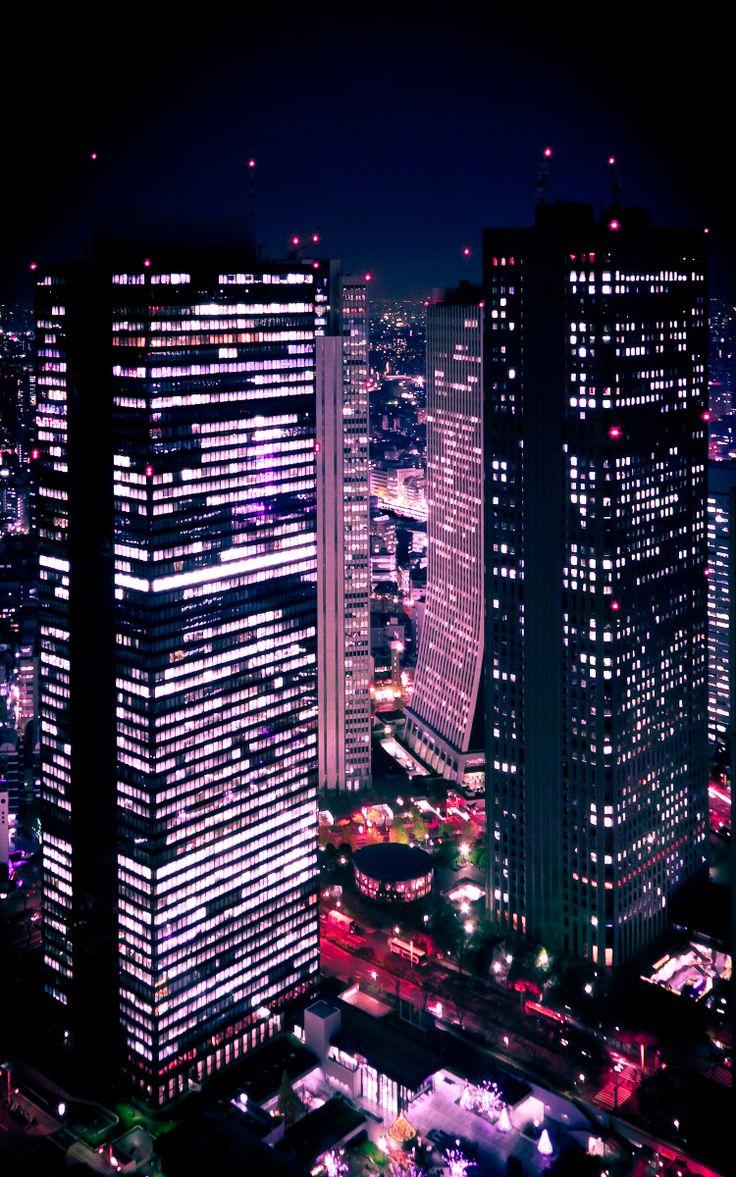 Looking out at night onto Shinjuku, Tokyo to see pink lights <3 x