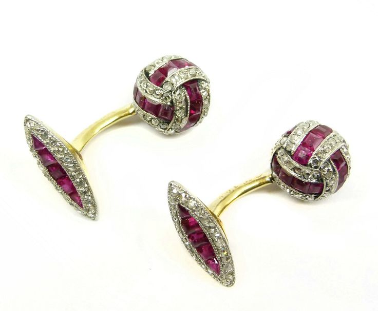 Pair of early 20th century ruby and diamond cufflinks, c.1915,   each having one end with cluster knot set with rubies and diamonds, the other end with a hinged navette shaped baton set with a line of rubies bordered by diamonds, millegrain set in platinum and gold with gold curved bar connections, rubbed serial numbers possibly 8221MD & 13086