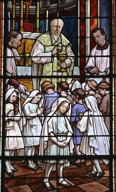 Stained Glass Window CommemoratingPope Pius X lowering the age for receiving first communion