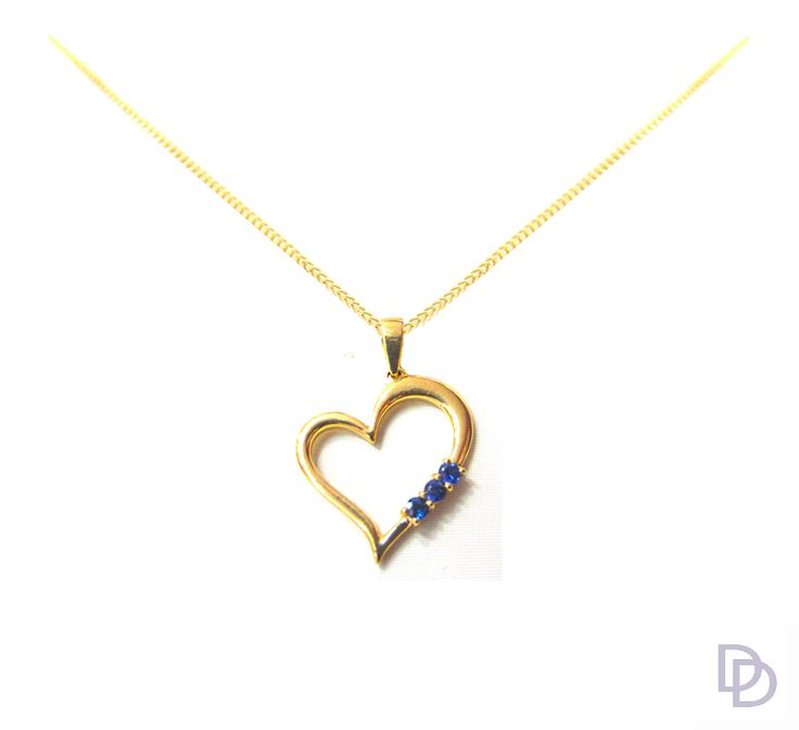 9ct yellow gold heart shape pendant set with blue sapphires