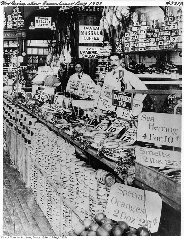 Staff behind the (very full!) counter of the William Davies Store (Queen and Bay), 1900s. #Toronto #Canada #vintage #supermarket #shopping