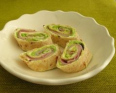 Ham pinwheel wraps:    1 multigrain tortilla, such as Mission brand      2 tablespoons light cream cheese      2 thin slices leg ham      3 tablespoons avocado, mashed    Method:    Spread tortilla evenly with cream cheese. Top with ham, and avocado.    Roll up tortilla tightly and then slice on an angle.