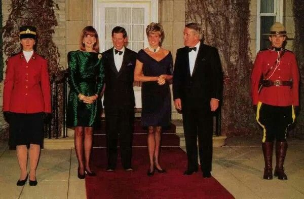 Update: October 29, 1991: The Prince Charles and Princess Diana Of Wales with Prime Minister Brian Mulroney and his wife Mila at a gala evening at the National Arts Centre in Ottawa for an official lunch hosted by the Governor-general of Canada.The Princess wore a dark blue fringed cocktail dress for this occasion (info and photo from Duchesseorange)