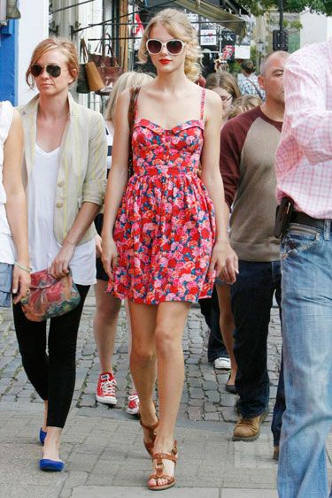 Taylor Swift with a friend in a floral Lipsy sundress