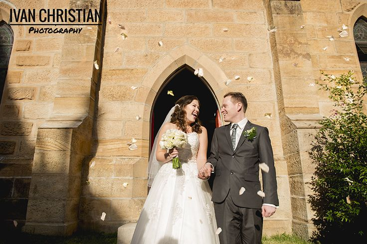 Morgan and Alasdair leave Manly Congregational Church showered in rose petals! - Ivan Christian Photography