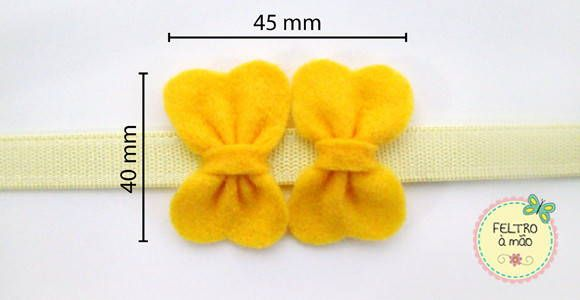 Headband para crianças e adultos decorada com 2 lacinhos de feltro. Elástico inteiriço feito sob medida.    Disponível nas cores:  - AMARELO  - BRANCO  - LILÁS  - MARFIM  - PINK  - PRETO  - ROSA  - VERDE  - VERMELHO