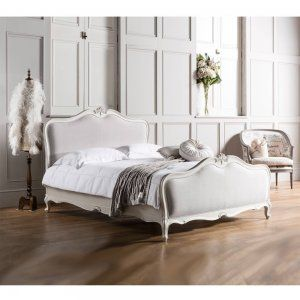 The French Bedroom's Chalk Linen Upholstered Bed Lifestyle will add a modern touch to your romantic French Bedroom.