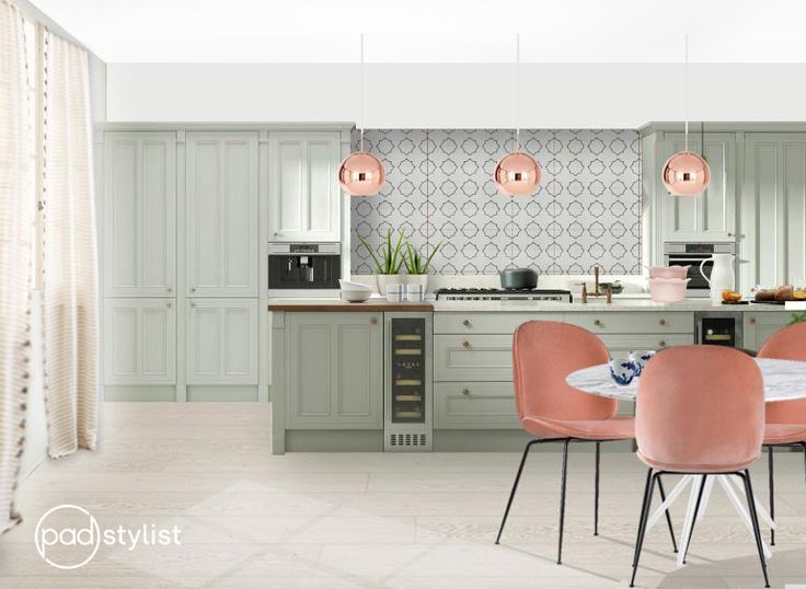 This fun yet elegant kitchen design is mixing traditional design style with modern elements. The shaker kitchen cabinets are traditional, complemented with playfulness of copper pendants, blush pink beetle chairs and a curtain with a cheery pom-pom trim.