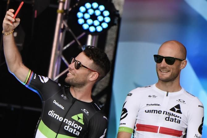 Mark Cavendish (L) takes a selfie picture next to Great Britain's Stephen Cummings as they stand on stage during the team presentation, TdF 2017.