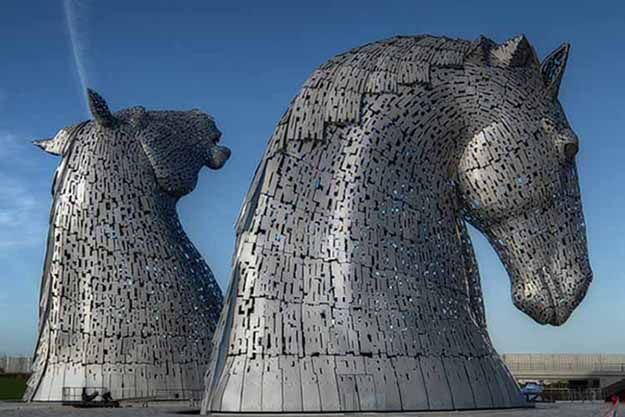 The Kelpies | Scotland's largest art installation has opened to the public. The Kelpies, two 300 tonne, 30m-tall horse head sculptures, sit in Helix Park in Falkirk. Artist Andy Scott took inspiration from the working horses which once pulled barges along the nearby Forth and Clyde Canal.