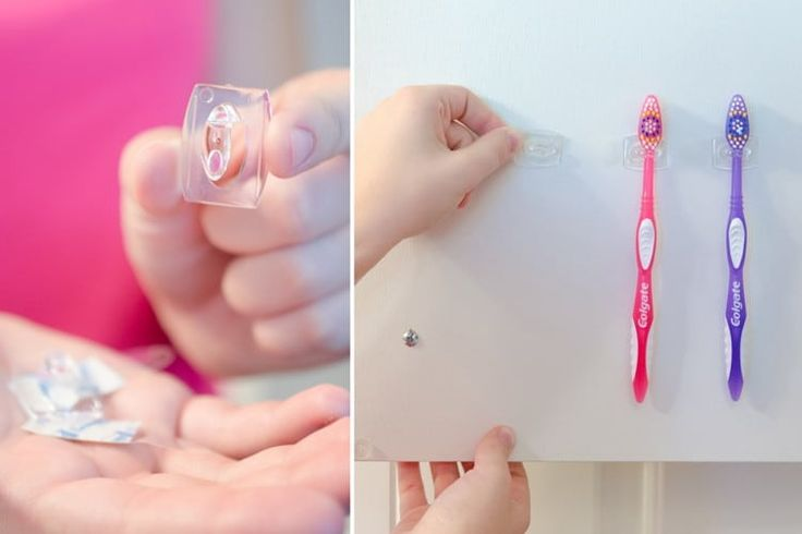 Turn a small command hook sideways to hang toothbrushes inside the medicine cabinet