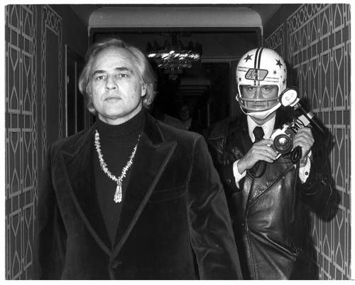 Brando by Ron Galella. The anti teeth being knocked out again helmet.