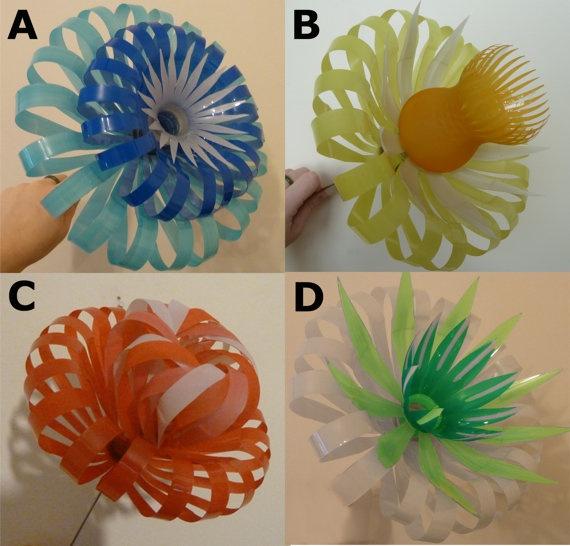 Plastic Bottle Flowers by SarahTurnerEcoDesign on Etsy, £15.00