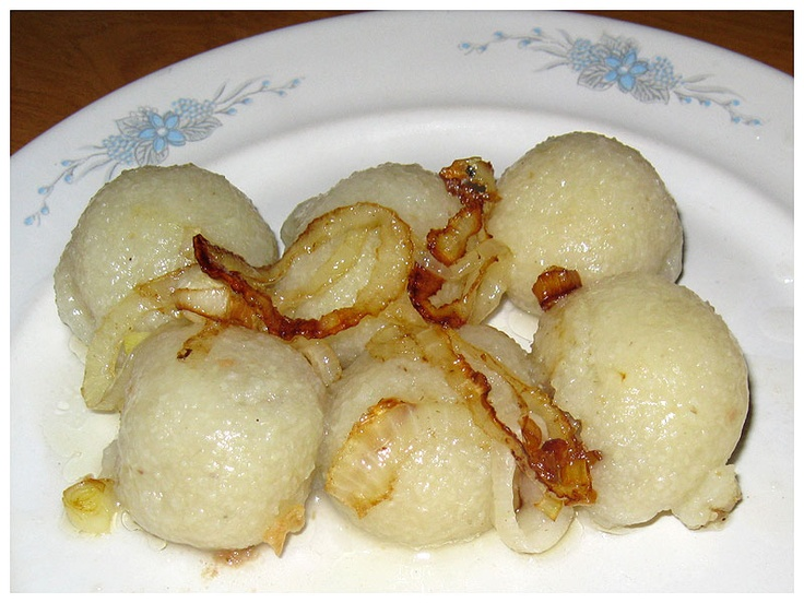 Pyzy z mięsem (potato dough balls filled with minced meat), served with fried onion and / or pork fat cracklings  #Poland #Polish_food