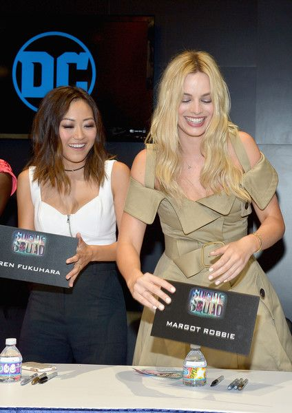 Margot Robbie Photos Photos - Actresses Karen Fukuhara (L) and Margot Robbie from the cast of Suicide Squad film participate in an autograph session for fans in DC's 2016 Comic-Con booth at San Diego Convention Center on July 23, 2016 in San Diego, California. - 'Suicide Squad' Cast Signing at San Diego Comic-Con 2016