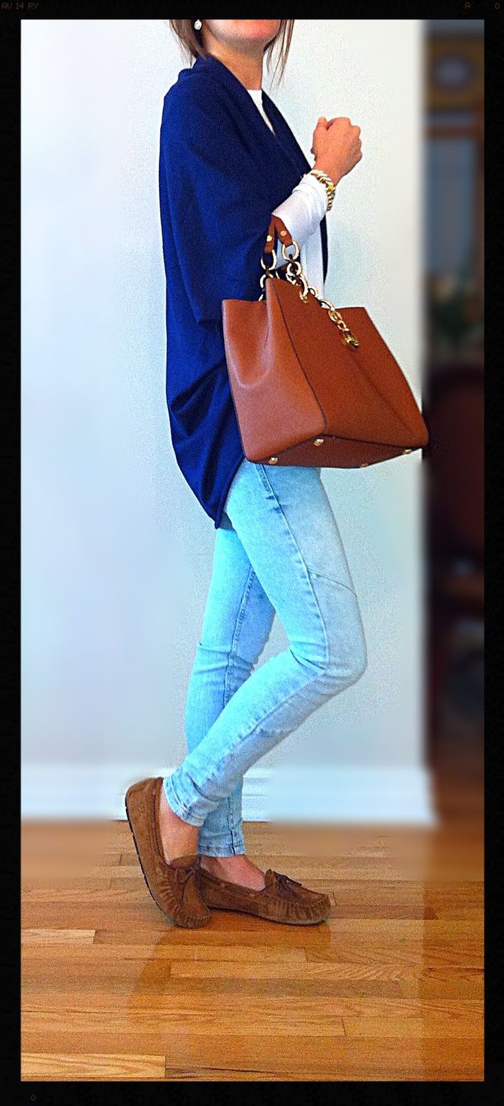 Classy casual comfy outfit- white Michael Kors long sleeve sweater, Light blue jeans from Zara, Navy blue shawl from Zara, light brown Ugg slipper loafers, Light brown Michael Kors tote, Coach white gold bracelet, Ralph Lauren beaded gold bracelet