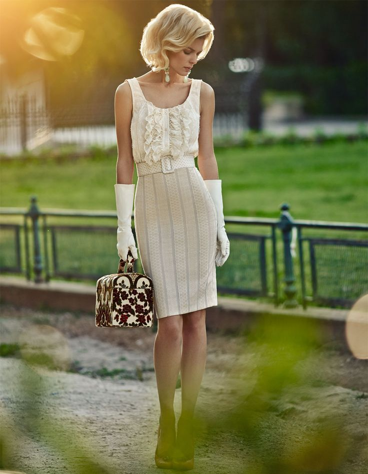 chic elegant and sophisticated look, wearing pencil skirt and volant top. 50s style