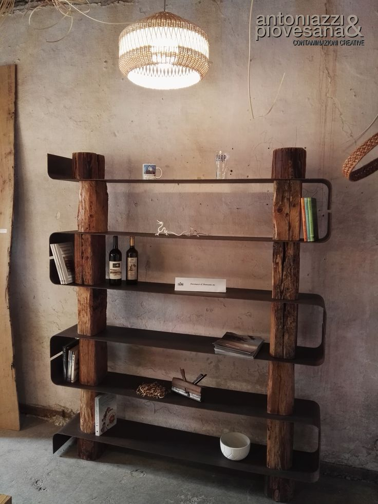 """""""Antiqua Bookcase"""" is a distinctive bookcase with antique taste but suitable for any kind of home location as well. It invites you on the past and it lets you enjoy pleasant moment at your home. It is the perfect item to place in cellars and wine shops/bars where keeping vintage wine bottles. Its main structure is on wood came from recycled beams and its metal shelves have powder coating finish.  produced by: http://www.antoniazziepiovesana.it/ designe by: Roberto Corazza"""