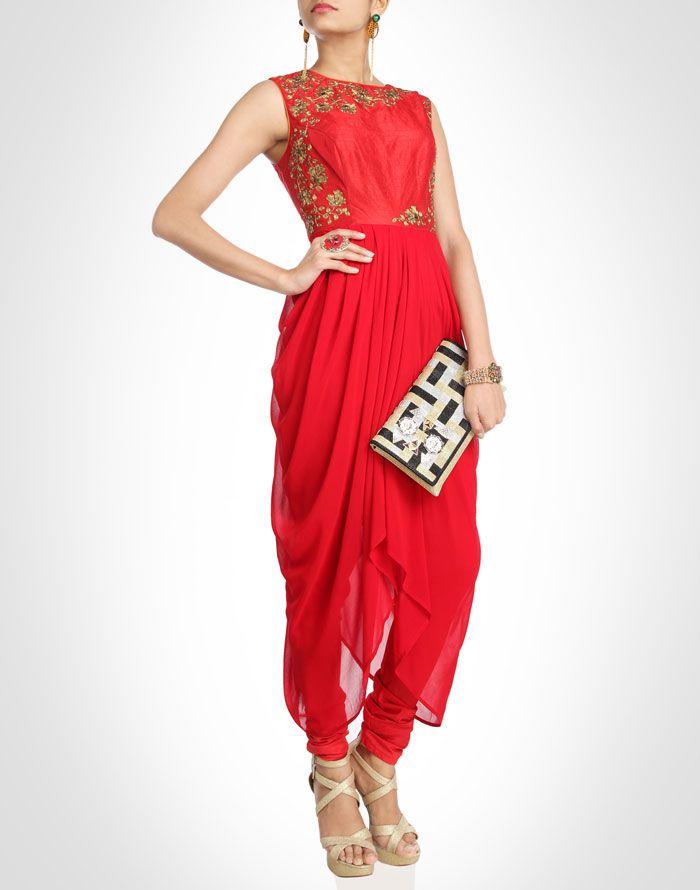 Striking red hued churidar kurta is artfully draped and pleated for a figure-enhancing shape.Shop Now: www.kimaya.in