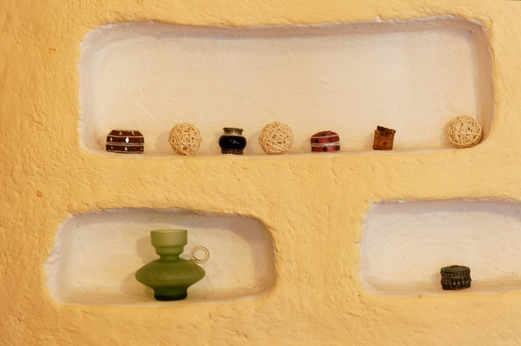 Simple shelf enclave decorated with sea urchins and trinkets collected from all over the world. www.thekenyaway.com