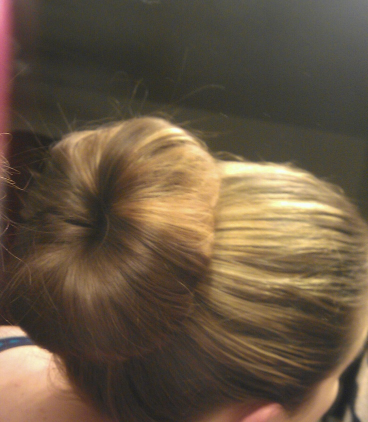 "my very first sock bun. my new favorite work hair, or hike hair, or I am so not doing my hair today hair. I just love it. At Sally beauty supply they sell a ""sock"" that works better its a net material and is great."