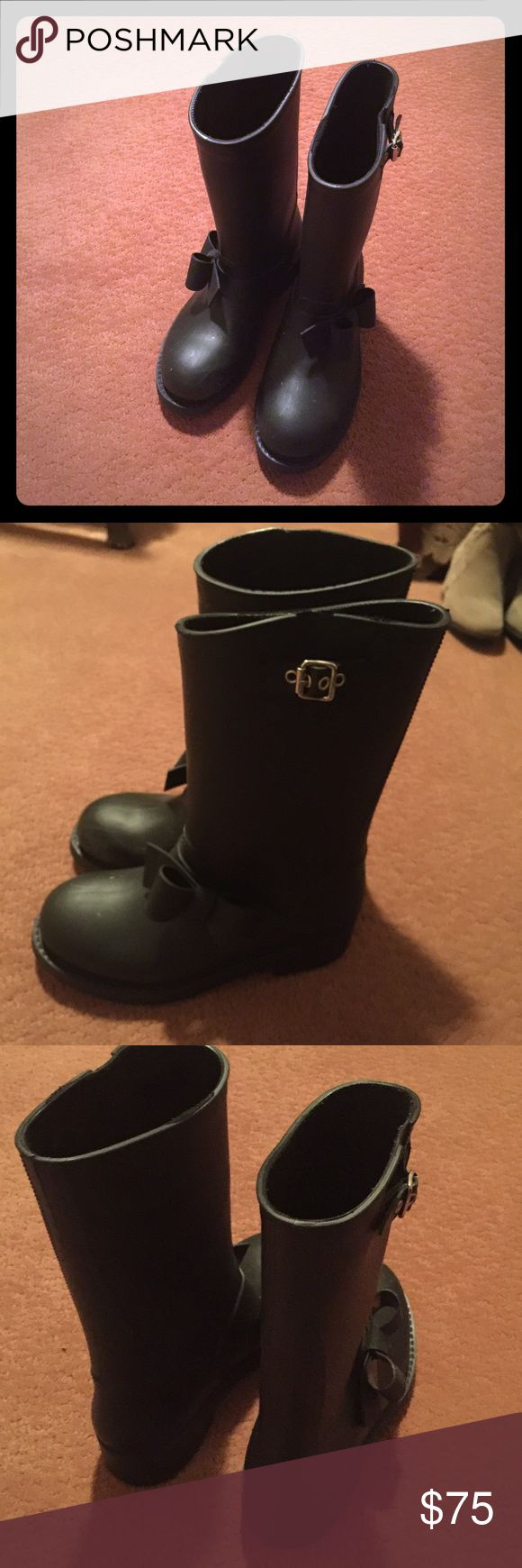 Black red Valentino bow rain boots 100% authentic These black bow red Valentino rain boots have been worn a few times in good condition has some scratches in the front they need a new home no box 100% authentic RED Valentino Shoes Winter & Rain Boots
