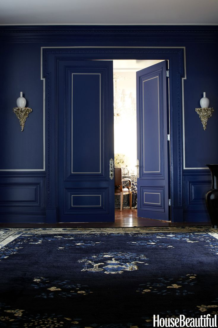 Ralph Lauren Paint transforms with a deep shade of moody blue and crisp white molding detail.