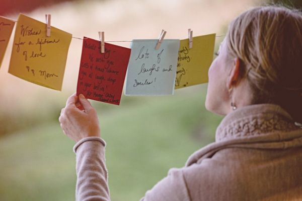 """Instead of a guest book we had guests write a wish for us on """"wish flags"""" that hung on a line with clothespins;"""
