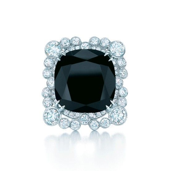 A ring with a cushion-cut black onyx and bezel-set diamonds in platinum that bubble like champagne, from The Great Gatsby Collection.