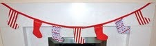 Christmas Stocking Garland    Brighten up your fireplace or wall with this Christmas Garland.  7 mini stockings on red bias tape perfect for hanging over your fire place.    Price: £7.99 including delivery      Available at www.joshandchloe.co.uk or www.facebook.com/JoshandChloe