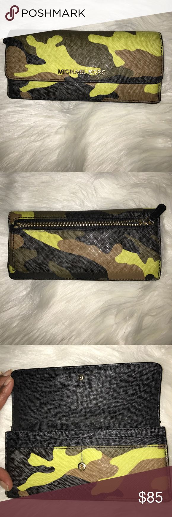 Rare Michael Kors camo wallet Rare Camo Michael Kors wallet with gold zipper hardware on the back,, lots slots to put you cards in. KORS Michael Kors Bags Wallets
