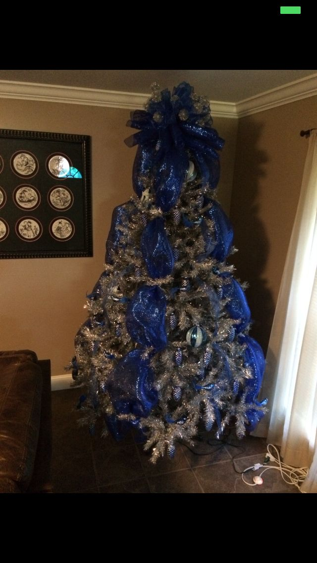 silver christmas tree with royal blue mesh and decorations using blue lights smith lambert 2014 flowers for you pinterest christmas blue christmas