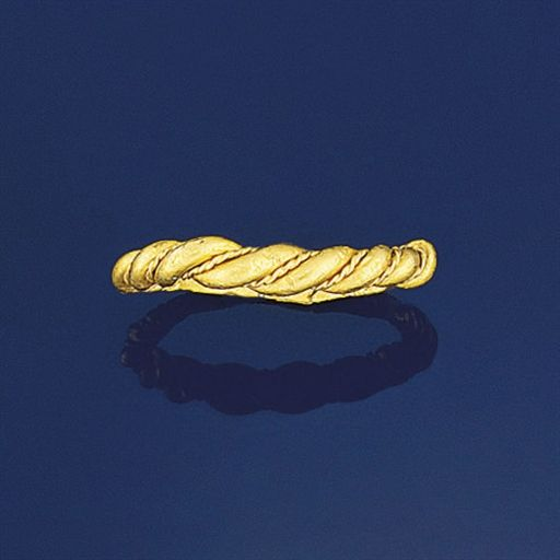 An early medieval gold ring  The hoop of twisted rope work with fine wire divisions tapering to a flattened section, 11th-12th century possibly late Anglo Saxon