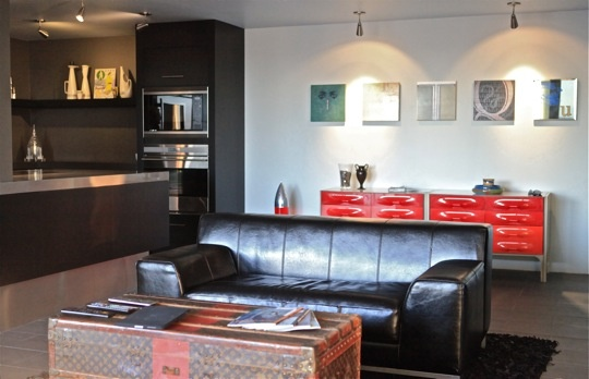 modern living room with an ikea kramfors leather sofa, and really cool louis vuitton trunk as a coffee table