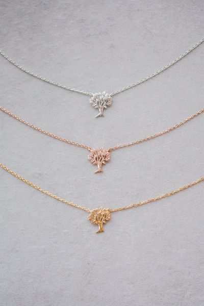 Tree necklace in gold, rose gold, and silver.