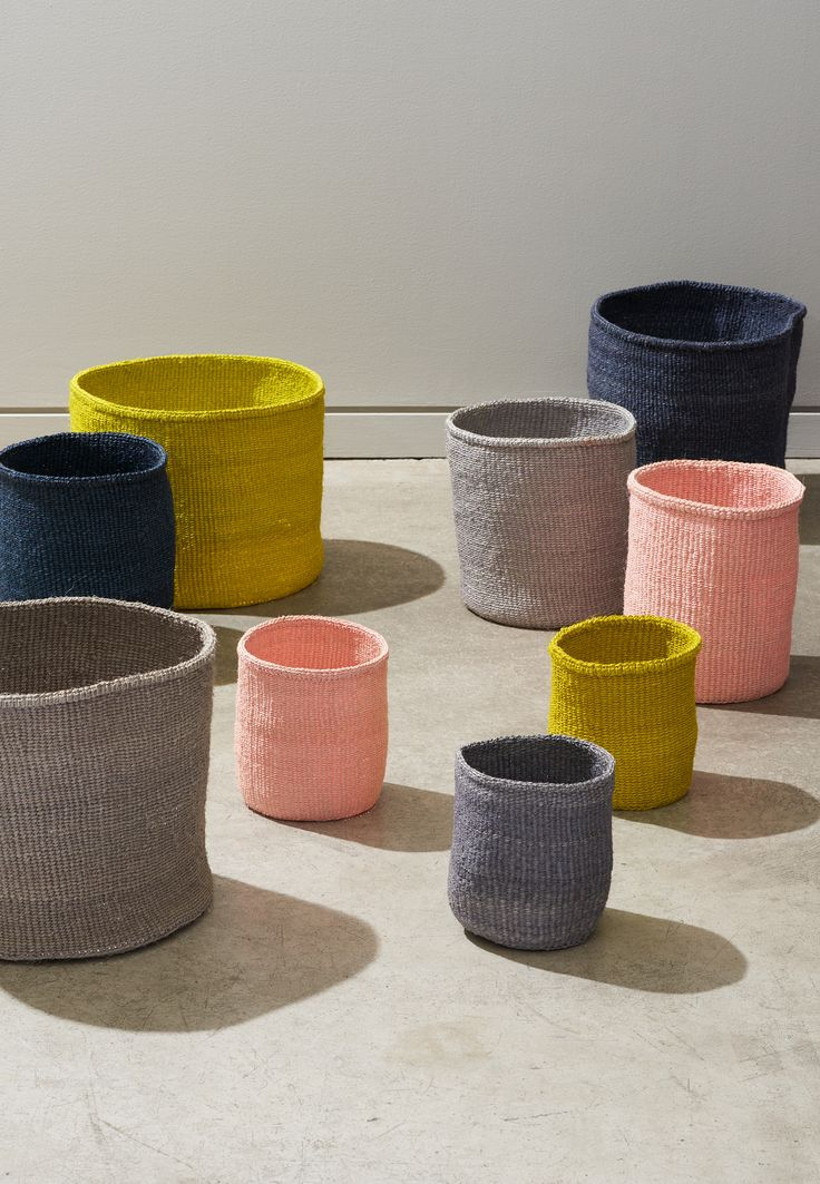800 women comprise the Kasigau Weavers, a group of artisans surrounding Mt. Kasigau in rural Kenya. These pastel baskets are a spring take on the weaver's hand-woven, traditional sisal baskets.
