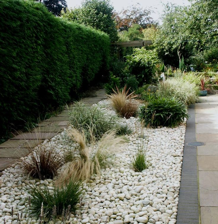 white pebble garden bed - either white or blue pebbles for side of house with the big blue pots