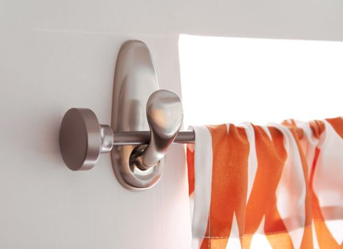 Command hooks used to hold a curtain rod - no holes
