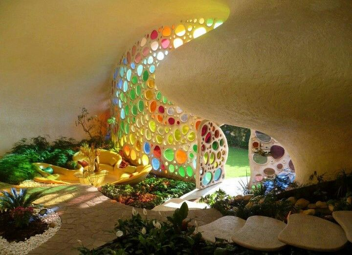 """glass wall in  """"earthship"""" Earthship Biotecture  An Earthship is a 'new' kind of building, a new kind of architecture defined by the following 6 principles: - Thermal/Solar Heating  Cooling  - Solar  Wind Electricity  - Contained Sewage Treatment  - Built with Natural  Recycled Materials  - Water Harvesting  - Food Production"""