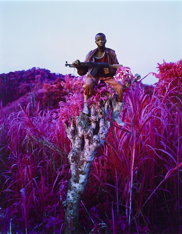 Photographer: Richard Mosse ~ From a series titled 'The Enclave', Mosse uses Infrared Photography to capture a warfare in Congo. The camera manages to capture hallucinatory and dreamlike imagery through the greens transformation to shimmering violets, in turn combining shifting landscapes with muted portraiture. I absolutely love how Mosse managed to take something so terrifying and complex, make it seem dream-like and alluring, then deny us any ability to focus on the apparent conflict…