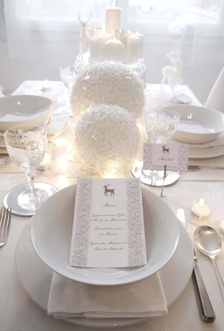 White Christmas table - large baubles wrapped with white sequins - fairy lights