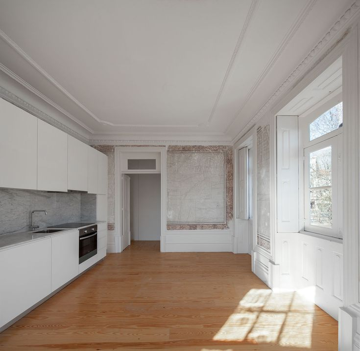 two houses in largo do trovador : Pitagoras Group . Kitchen . Wood