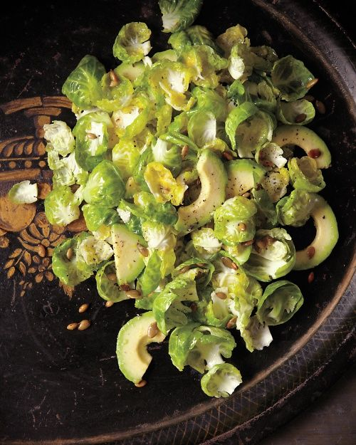 Brussels Sprout Salad with Avocado and Pumpkin Seeds: Tossed with avocado and coated in a bright lemon-Dijon dressing, the tender brussels sprout leaves make a showstopping salad, Wholeliving.com