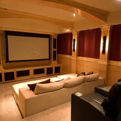 theater room in basement. super cool stadium seating