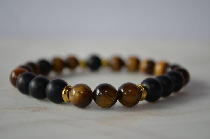 Excited to share the latest addition to my #etsy shop: Tiger's Eye Black Lava Grounding Bracelet. Stretch Bracelet. Protective Bracelet. Confidence Bracelet. Yoga Bracelet.