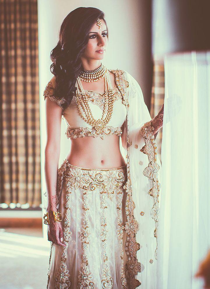Desi Weddings. White bridal lengha with gold embroidery. #whitelengha #lengha #bridallengha
