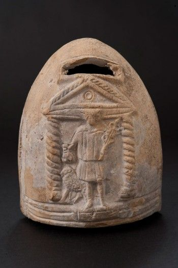 An ancient Roman terracotta savings bank in the form of a beehive; it is adorned with an image of the Roman god Mercury, deity of commerce, with his symbolic attributes of a caduceus and a moneybag. (John Hopkins Archaeological Museum)