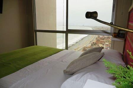 Ganhe uma noite no Private room with excellent  view of the ocean - Apartamentos para Alugar em Callao no Airbnb!