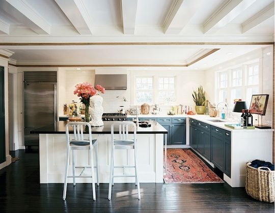 LOVE this kitchen, esp. semi-gloss navy cabinets against antique rug, and unique crown molding.